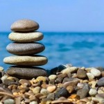 Cairn at the seaside illustrating relaxation and stress reduction