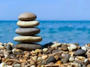 Cairn by the seaside illustrating relaxation and stress reduction